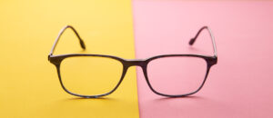 graduated glasses on colorful background 1