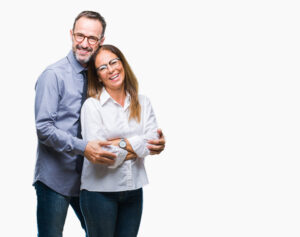 Middle age hispanic couple in love wearing glasses over isolated background happy face smiling with crossed arms looking at the camera. Positive person. 1