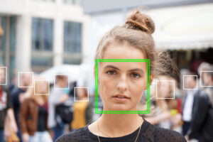 young woman picked out by face detection or facial recognition software 1