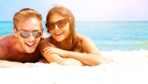 Happy Couple in Sunglasses Having Fun on the Beach. Summer 3